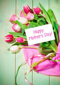 Bouquet of tulips and card — Stock Photo