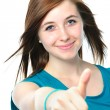 Female teenager shows a thumbs up — Stock Photo #39632399