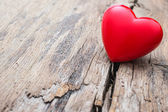 Red heart in crack of wooden plank — Stock Photo