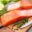 Raw salmon fish fillet with fresh herbs — Stok fotoğraf