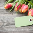 Stock Photo: Fresh tulips and tag
