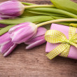 Pink tulips with a gift box — Stock Photo #41868793