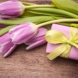 Stock Photo: Pink tulips with a gift box