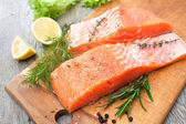 Salmon fish fillet with fresh herbs — Stock Photo