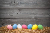 Eater eggs on old wooden background — Stock Photo