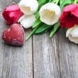 Stock Photo: Fresh tulips with a red heart