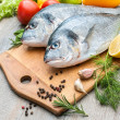 Fresh raw fish gilthead bream — Stock Photo