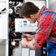 Technician servicing heating boiler — Stock Photo #42796421