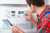 Technician servicing heating boiler — Stok fotoğraf