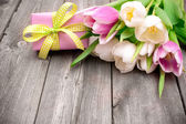 Fresh pink  tulips with a gift box — Stock Photo