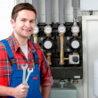 Technician servicing heating boiler — Stock Photo