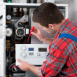 Technician servicing heating boiler — Stock Photo #43318949