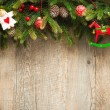 Christmas decoration over old wooden background — Stock Photo #49213739