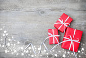 Gift boxes on wooden background — Stok fotoğraf