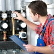 Technician servicing heating boiler — Stock Photo #50344447