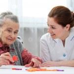 Senior woman with her elder care nurse — Stock Photo #50344455
