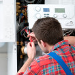 Technician servicing heating boiler — Stock Photo #50344461