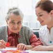 Senior woman with her elder care nurse — Stock Photo #50344473