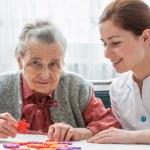 Senior woman with her elder care nurse — Stock Photo