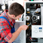 Technician servicing heating boiler — Stock Photo #50344485