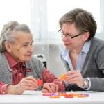 Senior woman with her elder care nurse — Stock Photo #50344493