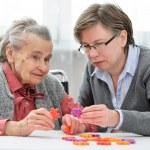 Senior woman with her elder care nurse — Stock Photo #50344515