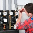 Technician servicing heating boiler — Stock Photo #50344529