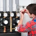 Technician servicing heating boiler — Stock Photo