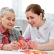 Senior woman with her elder care nurse — Stock Photo #50344551