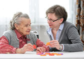 Senior woman with her elder care nurse — Stock Photo