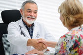 Doctor shaking hands to patient — Stock Photo