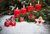 Red candles burning  in snow for fourth advent — Stockfoto