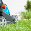 Lawn mower on a green meadow — Stock Photo #50731289