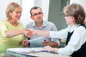 Couple talking with financial advisor — Stock Photo