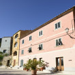 Old buildings on square, Poggio — Stockfoto #18256257