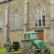 Old tractor and church, ardennes — Stock Photo