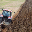 Tractor plowing field — Stock Photo #12073577