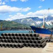 Iron wire in harbor with forklift and ship — Stock Photo #12083399