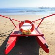 Old rescue boat on beach -  