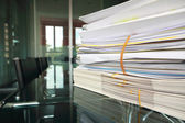Stack of documents or files in office desk — Stock Photo