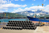 Iron wire in harbor with forklift and ship — Stock Photo
