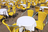 Yellow chairs and tables cafe — Stock Photo