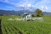 Agriculture, tractor and pesticide — Stock Photo