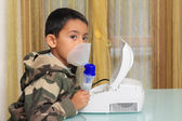 Child with inhalation mask — Stock Photo