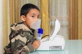 Child with inhalation mask — Stock Photo