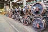 Train wheels in heavy factory — Stock Photo