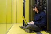Computer Technician working in datacenter — Stock Photo