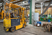 Forklift in workshop — Stock Photo