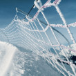 Safety net on ski run in italian alps - Stock Photo