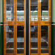 Closed sliding door of classic tram in Milan - Stock Photo